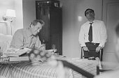 Hungarian war photographer and photojournalist Robert Capa visits American film director and screenwriter John Huston in hospital 1953