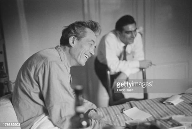 Hungarian war photographer and photojournalist Robert Capa visits American film director and screenwriter John Huston in hospital 1953
