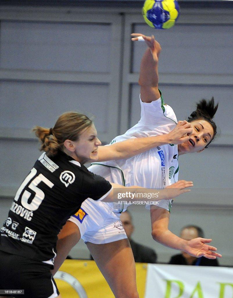Hungarian Zita Szucsanszky (R) of FTC Rail Cargo Hungaria is fouled by Slovenian Barbara Varlec-Lazovic (L) of RK Krim Mercator in the local sports hall of Dabas on February 17, 2013 during their EHF Women's Champions League handball match. AFP PHOTO / ATTILA KISBENEDEK