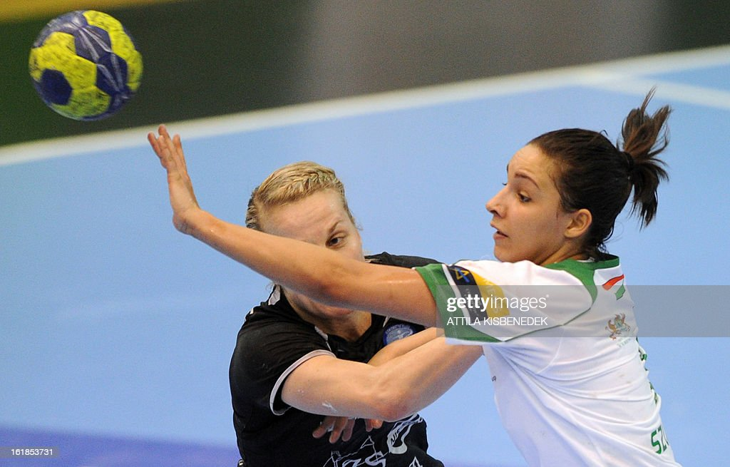 Hungarian Zita Szucsanszky (R) of FTC Rail Cargo Hungaria is pushed by Nina Worz (L) of Slovenian RK Krim Mercator in the local sports hall of Dabas on February 17, 2013 during their EHF Women's Champions League handball match.