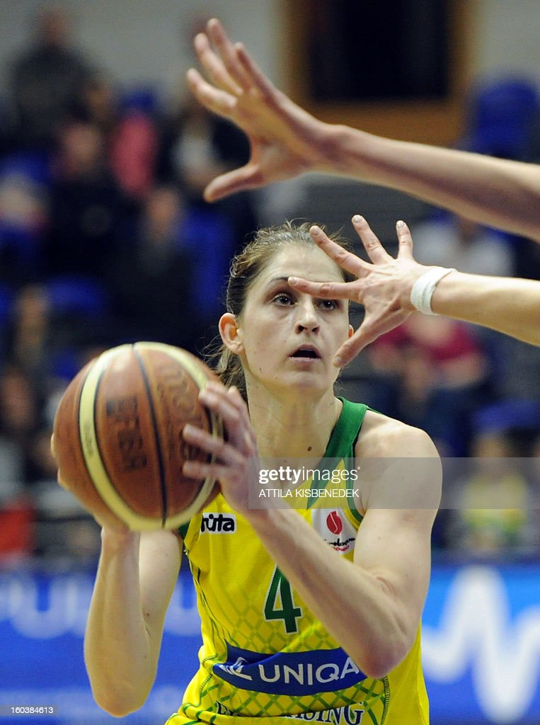 Hungarian Zsofia Fegyverneky of Hungarian UE Sopron prepares her basket against Russian Nadezhda Orenburg on January 30, 2013 during their basketball EuroLeague match in Sopron, Hungary.