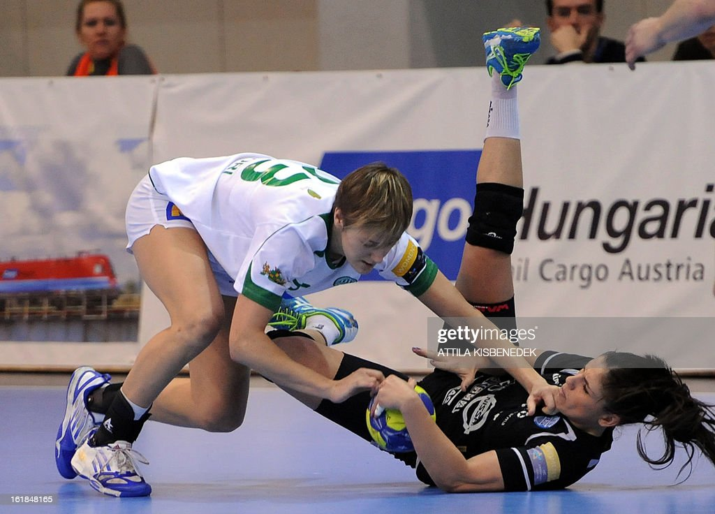 Hungarian Zsuzsanna Tomori (L) of FTC Rail Cargo Hungaria fights for the ball with Slovenian Barbara Varlec-Lazovic (R) of RK Krim Mercator in the local sports hall of Dabas on February 17, 2013 during their EHF Women's Champions League handball match.