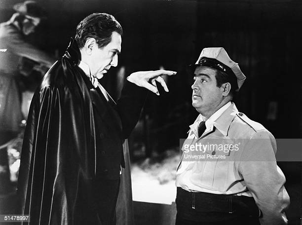 Hungarianborn actor Bela Lugosi attempts to hypnotize American actor Lou Costello as Wilbur Grey in a scene from 'Abbott Costello Meet Frankenstein'...