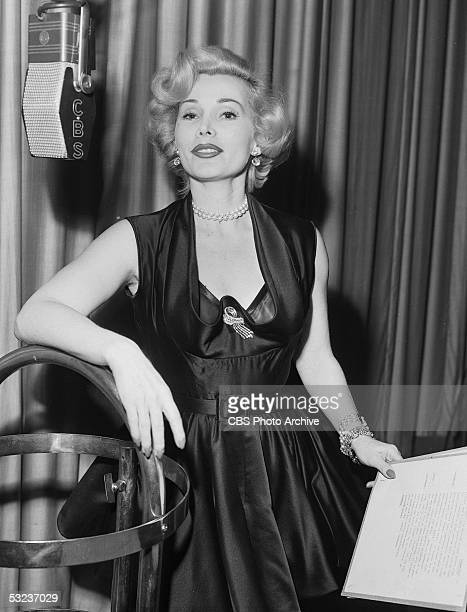 Hungarianborn actress Zsa Zsa Gabor poses with her script and a CBS microphone during rehearsals for her performance in 'African Queen' on the CBS...