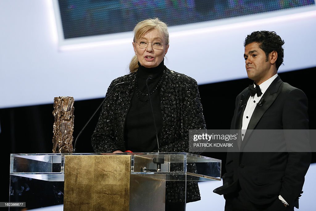 Hungarian-born French producer Margaret Menegoz (L) speaks beside French actor and President of the ceremony Jamel Debbouze after receiving the Best Film award for Austrian director Michael Haneke's film 'Amour' (Love) during the 38th Cesar Awards ceremony on February 22, 2013 at the Chatelet theatre in Paris. AFP PHOTO / PATRICK KOVARIK