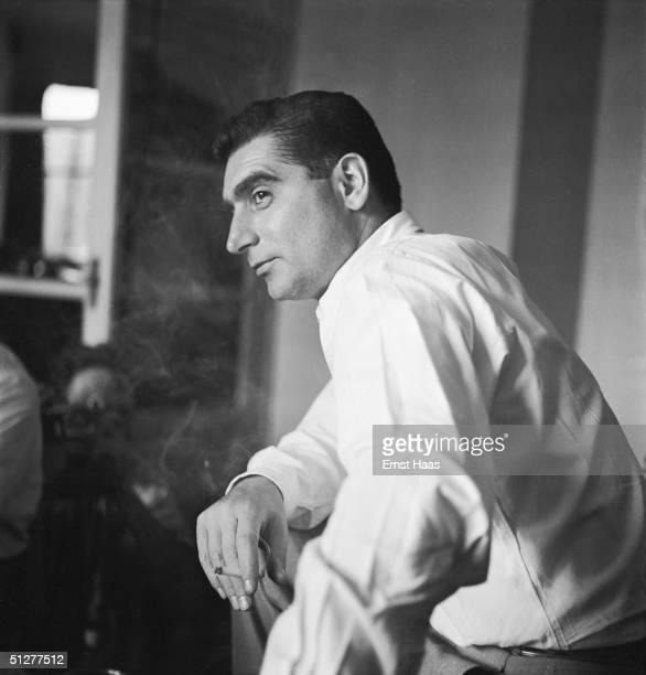 Hungarianborn photojournalist Robert Capa at a meeting of the Magnum photographic cooperative Paris circa 1947