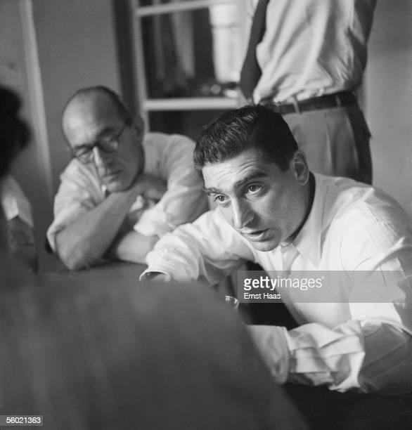 Hungarianborn photojournalist Robert Capa chairs a meeting of the Magnum photographic cooperative Paris circa 1947