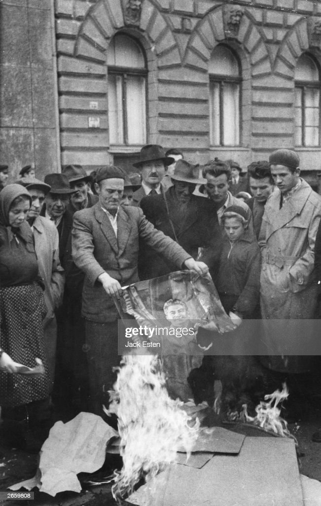 Hungarians burning a portrait of Stalin during the Russian supression of their anti-communist revolution. Original Publication: Picture Post - 8730 - Hungary's Last Battle For Freedom - pub. 1956