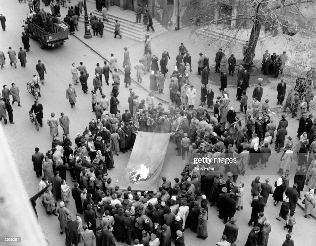 Hungarians burning the Russian flag in Budapest, after the Russian invasion of Hungary. Original Publication: Picture Post - 8730 - Hungary's Last Battle For Freedom - pub. 1956