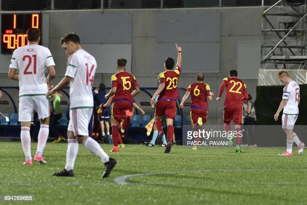 Hungarian's players react after losing as Andorra's players celebrate at the end of the FIFA World Cup 2018 football qualifier between Andorra and...