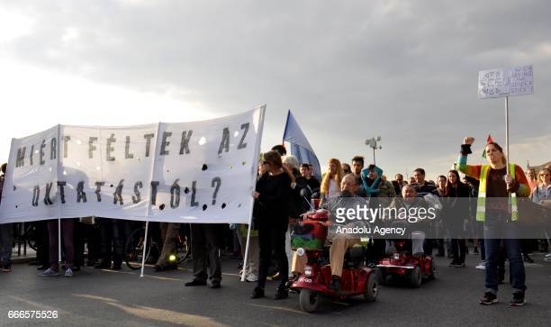 Hungarians take part in a protest in support of Central European University after the approval of legislation that could force the closure of foreign...