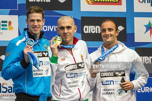 Hungaria's gold medalist Laszlo Cseh Germany's silver medalist Philip Heintz and Portugals bronze medalist Diogo Filip Sjoedin stand on the podium...