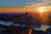 Hungary, Budapest, Danube river and Parliament Building at sunset