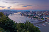 Hungary, Budapest, Danube river with Elisabeth Bridge and Chain Bridge, afterglow