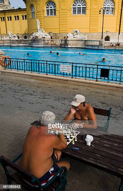 Hungary Budapest Pest Bathers playing chess in summer at Szechenyi thermal baths largest in Europe