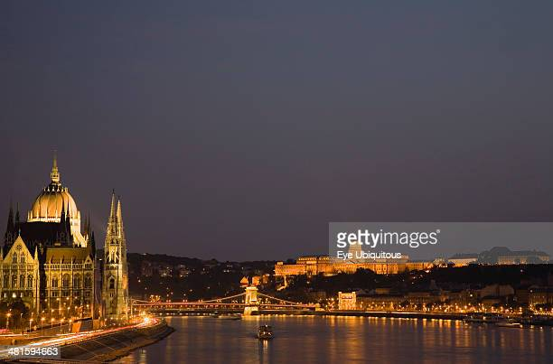 Hungary Budapest View along the River Danube at night with the Parliament building on the left the Chain Bridge and the Royal Palace on the right all...