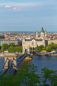 Hungary, Budapest, View to Pest with Chain Bridge and Danube river, Palais Gresham and St. Stephens Basilica