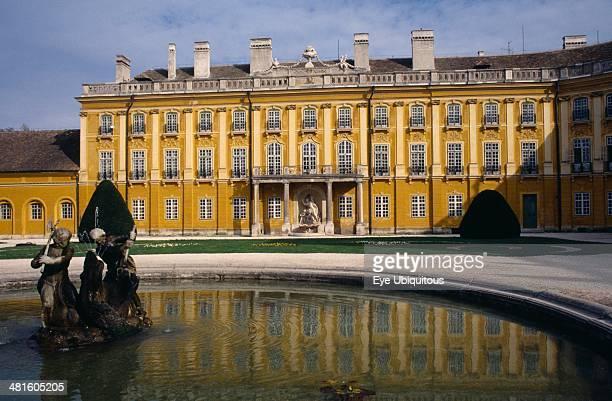 Hungary Burgenland Eisenstadt Schloss Esterhazy Palace yellow painted exterior seen from across a water fountain