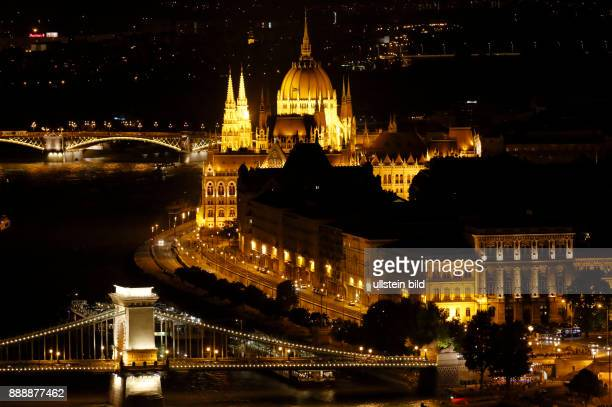 Hungary Central Hungary Budapest Danube Capital City night shot illumination panoramic view from Buda across the Chain Bridge to Pest behind the...