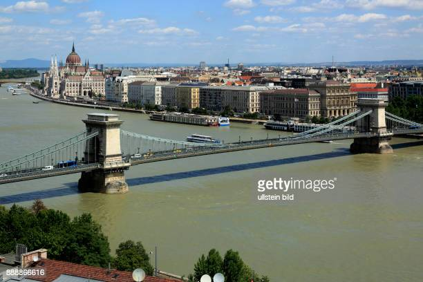 Hungary Central Hungary Budapest Danube Capital City panoramic view from Buda across the Chain Bridge to Pest behind the Hungarian Parliament...
