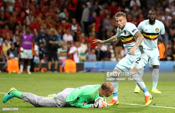 Hungary goalkeeper Gabor Kiraly gathers at the feet of Belgium's Toby Alderweireld