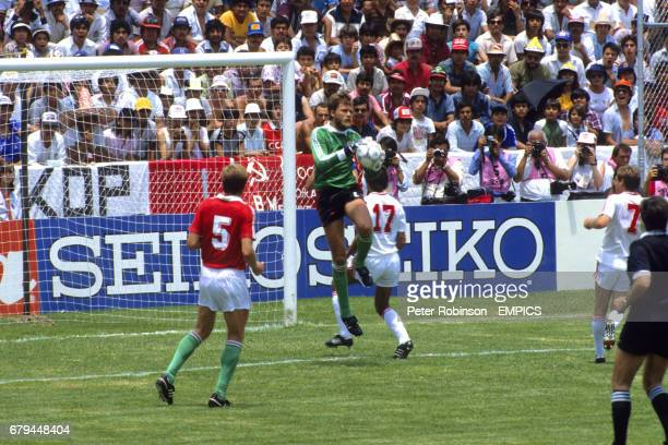 Hungary goalkeeper Peter Disztl catches the ball ahead of the Soviet Union's Vadym Yevtushenko