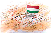 The flag of Hungary pinned on the map. Horizontal orientation. Macro photography.
