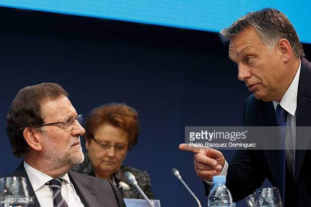 Hungary Prime Minister Viktor Orban chats with Spanish Prime Minister Mariano Rajoy during a plenary session of the European People's Party Congress...