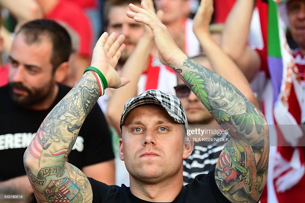 A Hungary supporter applauds prior to the Euro 2016 round of 16 football match between Hungary and Belgium at the Stadium Municipal in Toulouse on June 26, 2016. / AFP / ATTILA