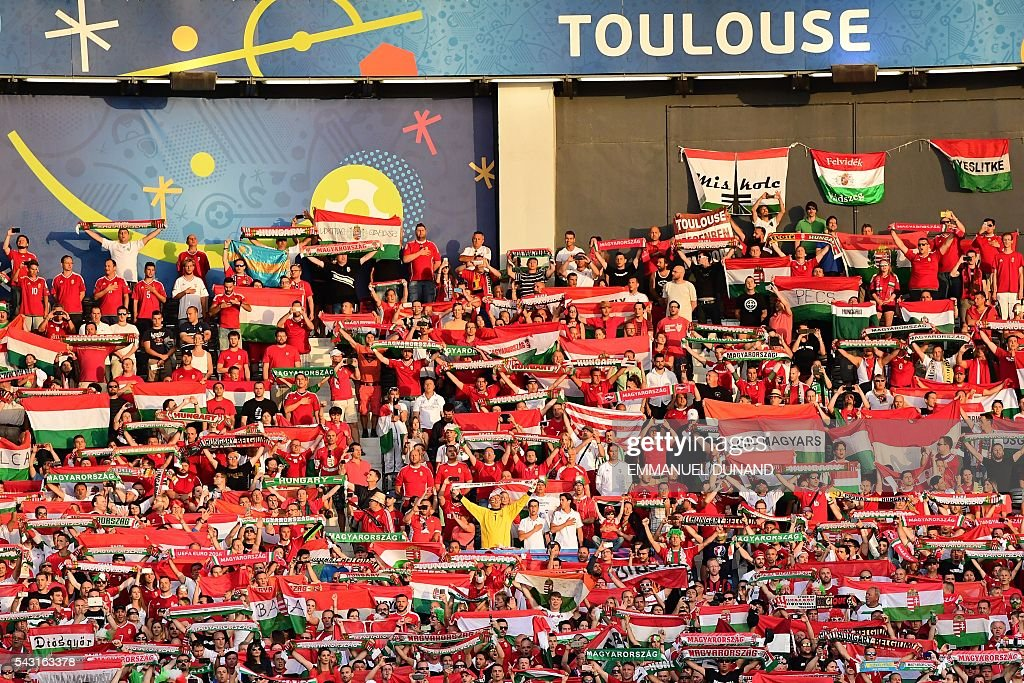 Hungary supporters holds scarves during the Euro 2016 round of 16 football match between Hungary and Belgium at the Stadium Municipal in Toulouse on June 26, 2016. / AFP / EMMANUEL