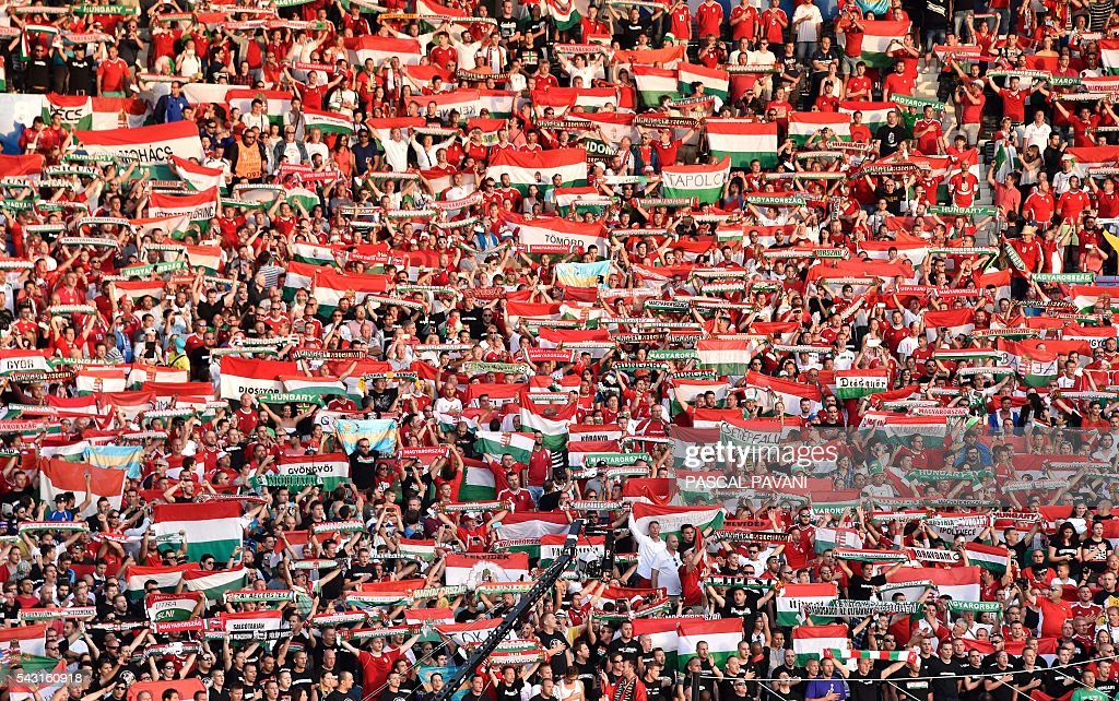 Hungary supporters wave scarves during the Euro 2016 round of 16 football match between Hungary and Belgium at the Stadium Municipal in Toulouse on June 26, 2016. / AFP / Pascal PAVANI