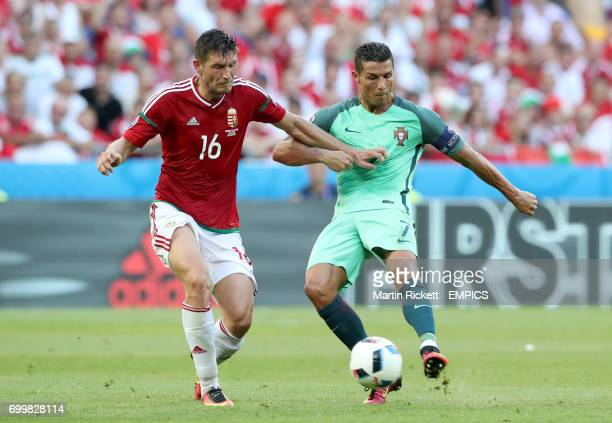 Hungary's Adam Pinter and Portugal's Cristiano Ronaldo battle for the ball