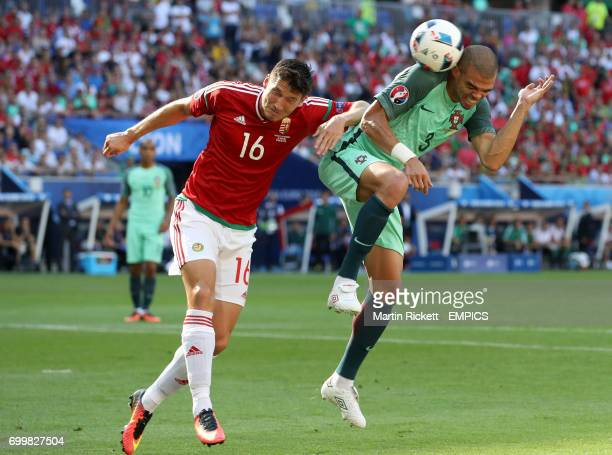 Hungary's Adam Pinter and Portugal's Pepe battle for the ball