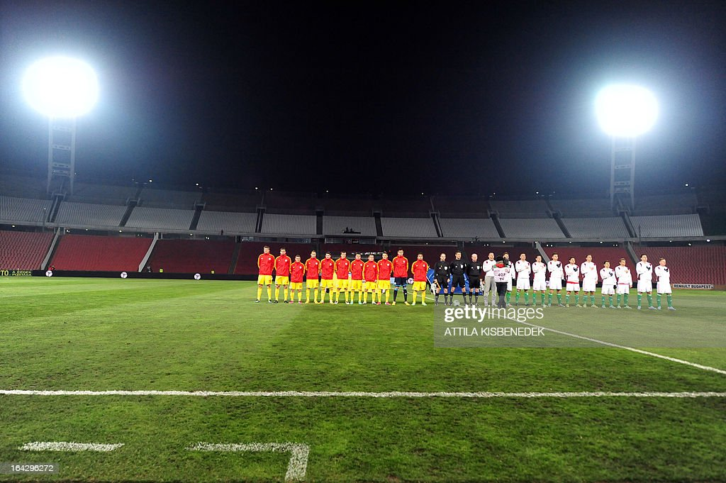 Hungary's and Romania's players listen to the national antems in the empty statium prior the Hungary vs Romania FIFA 2014 World Cup qualifying football match in Budapest, on March 22, 2013. FIFA ordered Hungary to play the 2014 World Cup qualifier match behind closed doors after fans hurled anti-Semitic abuse during a friendly match with Israel in August 2012.