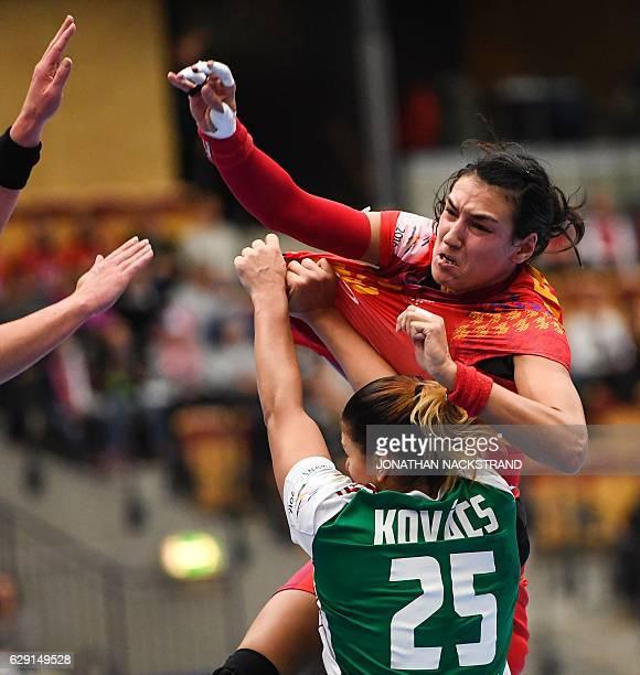 Hungary's Anna Kovacs tries to stop Romania's Cristina Neagu as she throws the ball during the Women's European Handball Championship Group II match...