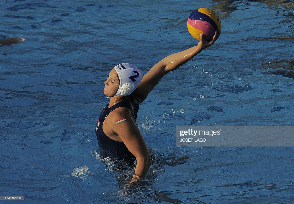 Hungary's Anna Krisztina Illes scores a penalty against Brazil during the preliminary round of the women's water polo at the FINA World Championships on July 21, 2013 in Bernat Picornell pools in Barcelona. Hungary won the match 20-6