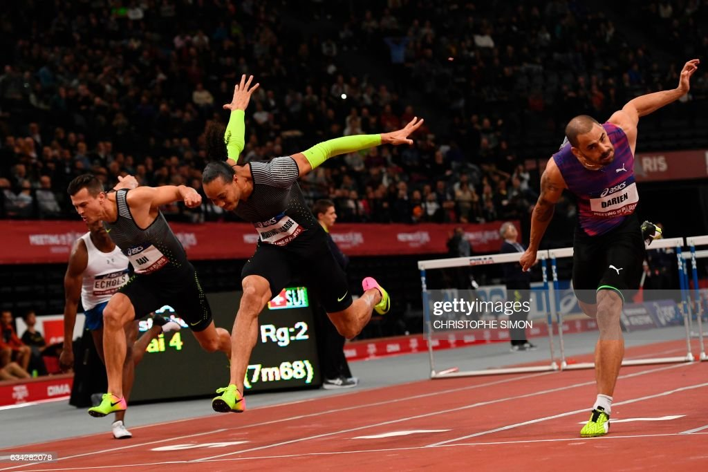 TOPSHOT - (From L) Hungary's Balazs Baji, France's Pascal Martinot-Lagarde and France's Garfield Darien compete in the men's 60m hurdles final during the Meeting de Paris Indoor athletics competition in Paris on February 8, 2017. /