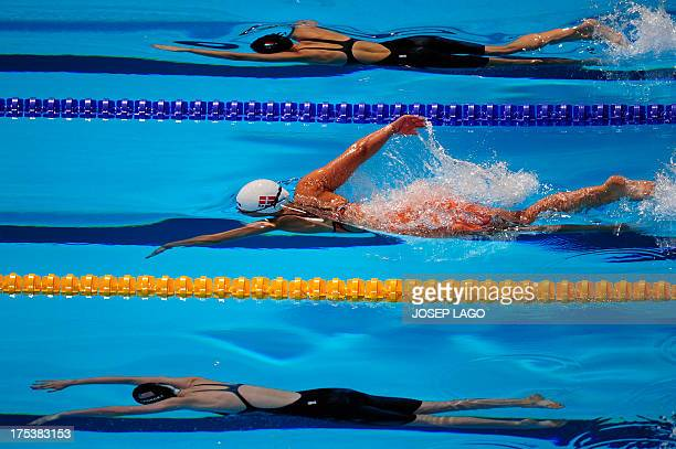 Hungary's Boglarka Kapas Denmark's Lotte Friis and US swimmer Katie Ledecky compete in the final of the women's 800metre freestyle swimming event in...