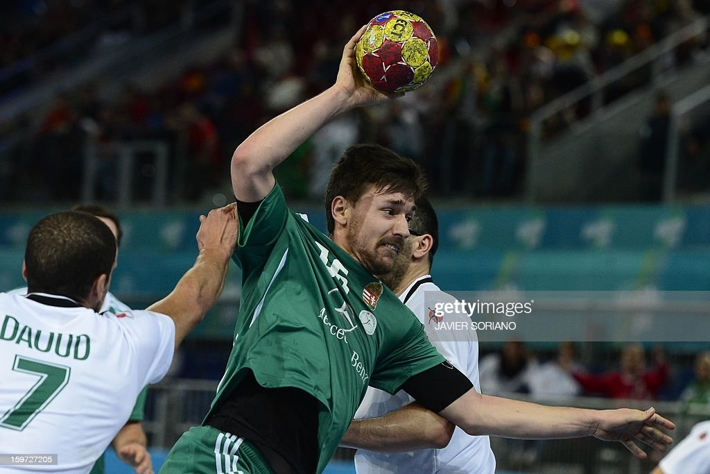 Hungary's centre back Mate Lekai (R) shoots past Algeria's centre back Hichem Daoud during the 23rd Men's Handball World Championships preliminary round Group D match Hungary vs Algeria at the Caja Magica in Madrid on January 19, 2013.