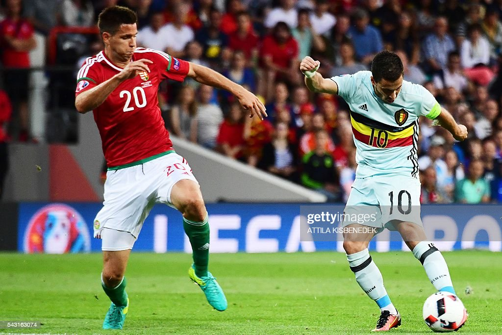 Hungary's defender Richard Guzmics (L) vies for the ball with Belgium's forward Eden Hazard during the Euro 2016 round of 16 football match between Hungary and Belgium at the Stadium Municipal in Toulouse on June 26, 2016. / AFP / ATTILA