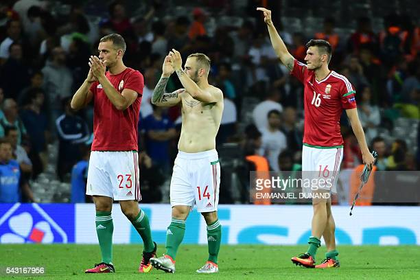 Hungary's defender Roland Juhasz Hungary's forward Gergo Lovrencsics and Hungary's midfielder Adam Pinter reacts after losing the Euro 2016 round of...