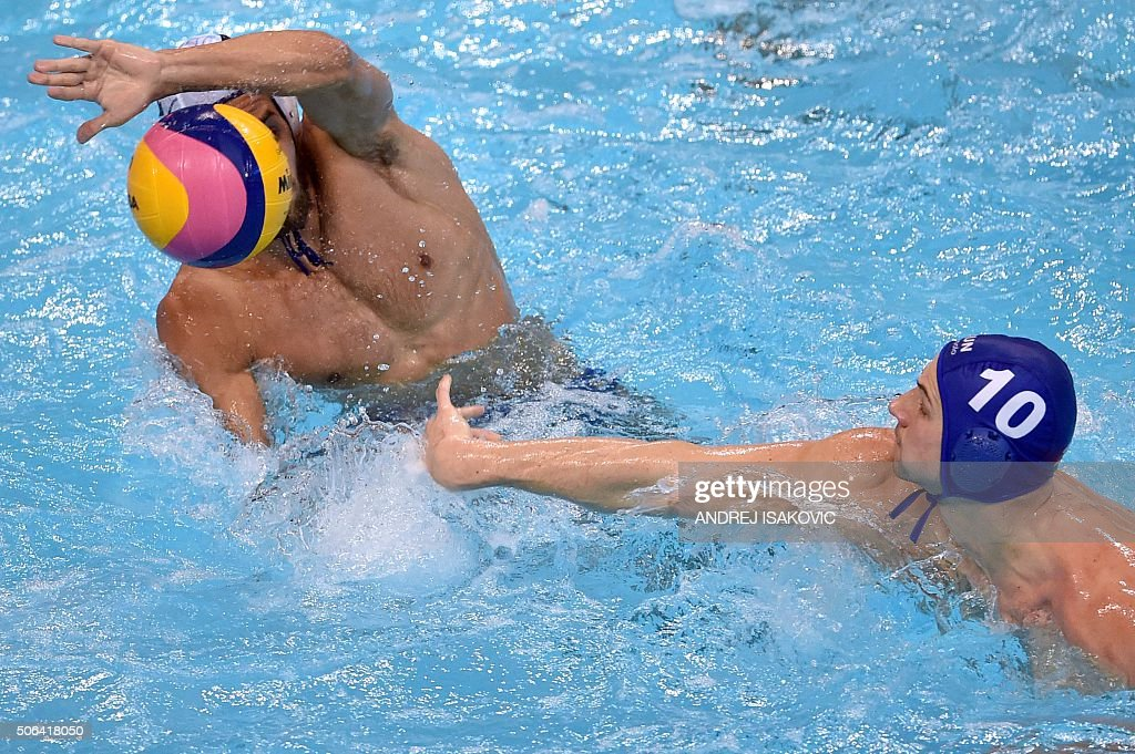 Hungary's Denes Andor Varga shoots the ball past Greece's Christodoulos Kolomvos during the bronze medal match between Greece and Hungary at the 2016...