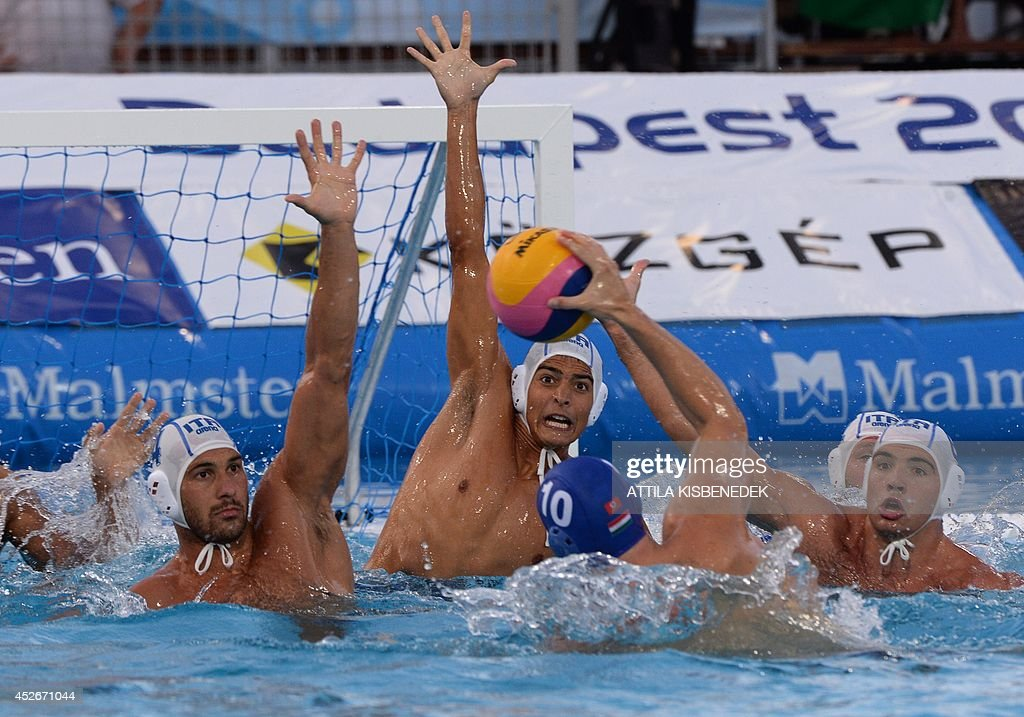 Hungary's Denes Varga tries to score during the Water Polo European Championships men's semifinal match Italy vs Hungary in Budapest on July 25 2014...