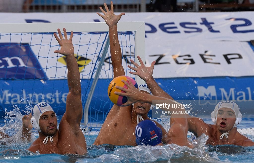 Hungary's Denes Varga tries to shot past Italy's players during the Water Polo European Championships men's semifinal match Italy vs Hungary in...