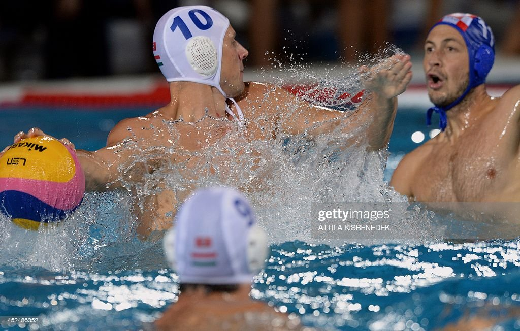 Hungary's Denes Varga vies with Croatia's Andelo Setka during the men's Water Polo European Championships match Hungary vs Croatia in Budapest on...