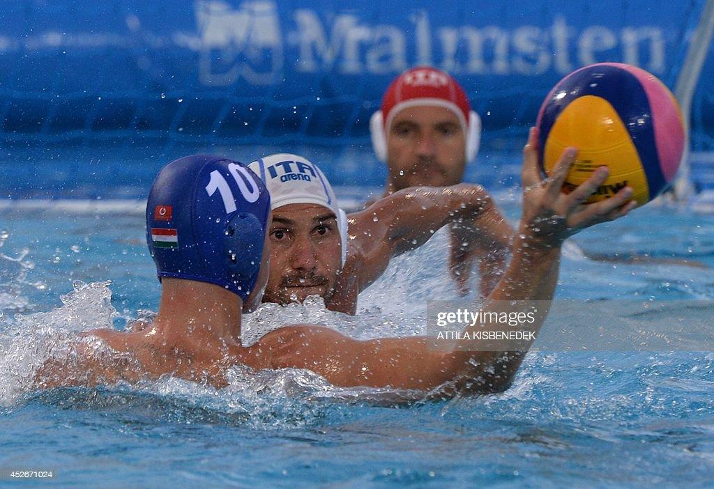 Hungary's Denes Varga vies with Italy's Pietro Figioli during the Water Polo European Championships men's semifinal match Italy vs Hungary in...