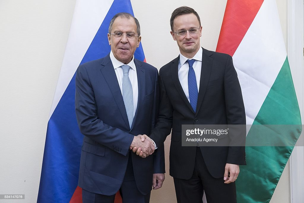 Hungary's Foreign Minister Peter Szijjarto (R) and Russian Foreign Minister Sergei Lavrov (L) shake each other's hands , at Hungarian Foreign Ministry, in Budapest, Hungary on May 25, 2016.