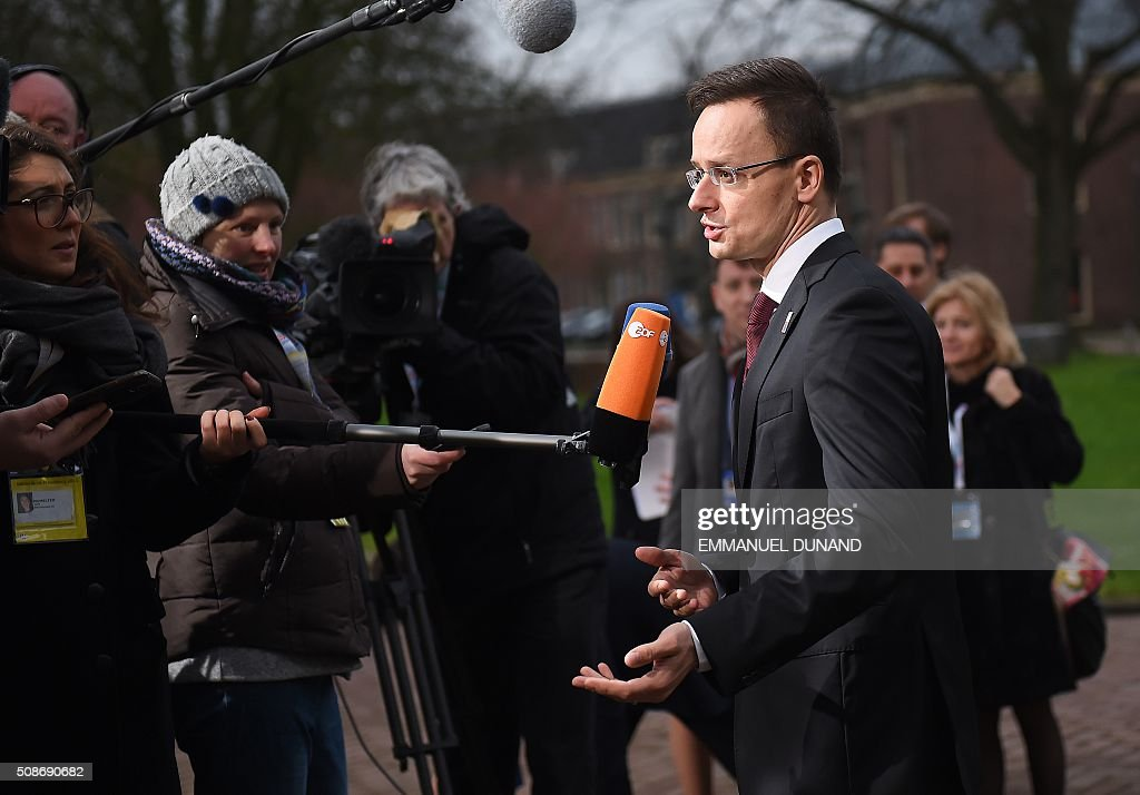 Hungary's Foreign Minister Peter Szijjarto answers journalists' questions as he arrives to take part in a EU foreign ministers meeting in Amsterdam, on February 6, 2016. The European Union on Wednesday finally reached agreement on how to finance a three-billion-euro ($3.3-billion) deal to aid Syrian refugees in Turkey, in exchange for Ankara's help in stemming the flow of migrants. / AFP / EMMANUEL DUNAND