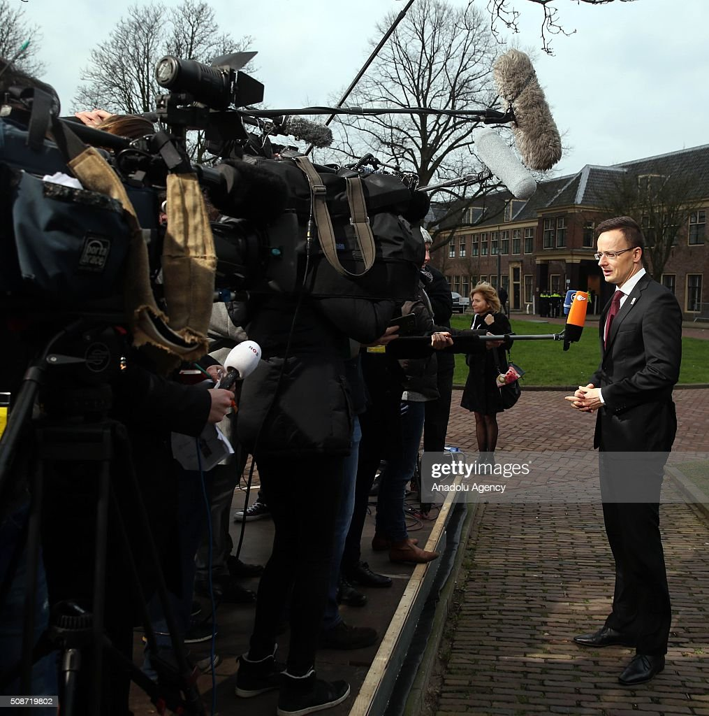Hungary's Foreign Minister Peter Szijjarto answers journalists' questions as he arrives to take part in Informal Gymnich meeting of EU foreign ministers in Amsterdam, Netherlands on February 6, 2016.