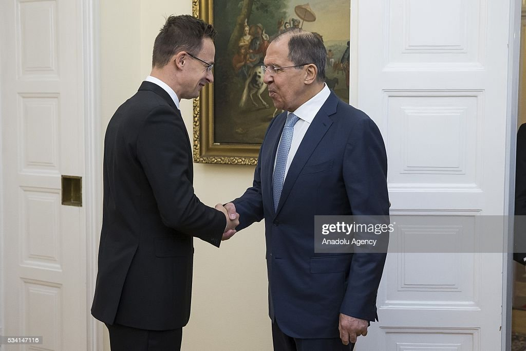 Hungary's Foreign Minister Peter Szijjarto (L) welcomes Russian Foreign Minister Sergei Lavrov (R), at Hungarian Foreign Ministry, in Budapest, Hungary on May 25, 2016.